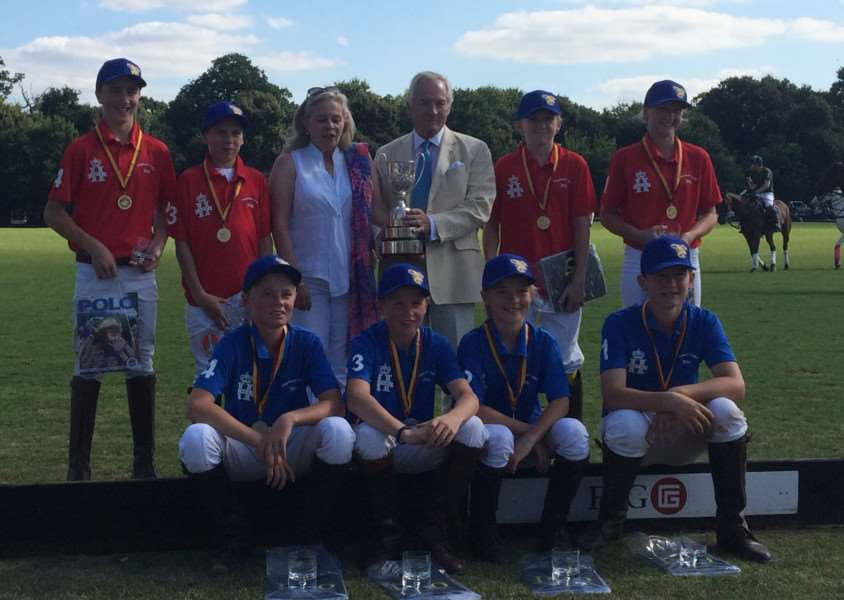 Marcus with the Young England squad who played for the Colts Cup at Ham Polo Club in August. Nicholas Coloquon-Denvers, chairman of the 'Federation of International Polo (FIP), presents the trophy EMN-160212-113733002