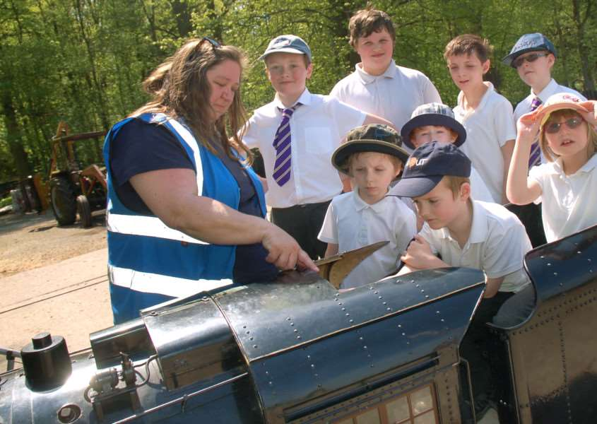Stapleford Miniature Railway volunteer Ruth Grice with some of the Sherard special needs children before their ride on a miniature locomotive EMN-161005-090616001