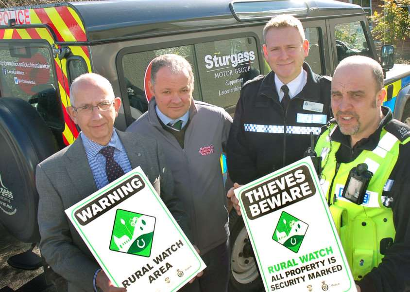 Pictured from left with some of the Rural Watch signs are Stephen Jeal, Melton NFU Mutual senior group secretary, Hugh Brown, cheif executive officer of Gillstream Markets Ltd which manages Melton Market, Leicestershire Police deputy chief constable Roger Bannister and Pc Mark Longden, dedicated neighbourhood officer covering the Vale of Belvoir EMN-160223-175011001
