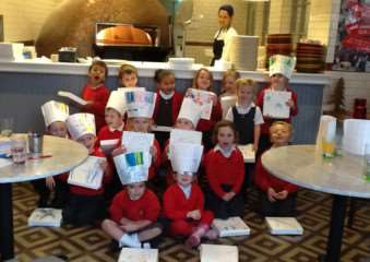Children at English Martyrs take part in an Italian lesson at Wildwood restaurant in Oakham EMN-141112-173833001