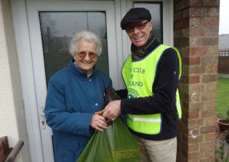Rutland Lions president Allan Grey gives a parcel to Phyllis Bell in Ketton